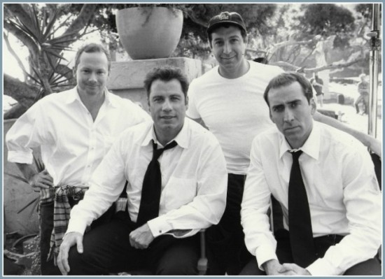 (Michael Colleary and fellow screenwriter Mike Werb standing, John Travolta and Nic Cage seated.)